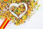 Heart, multicolored pencils and varicolored wooden shavings — Stock Photo