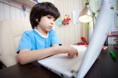 Distance learning, a boy with computer — Stock Photo