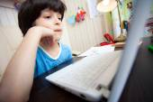 Distance learning, a child with computer — Foto de Stock
