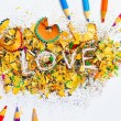 The word LOVE on the background from pencil shavings — Stock Photo #69173419