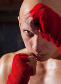 Portrait of a boxer with red bandages — Stock Photo