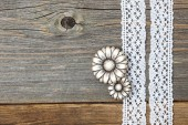 Vintage metal buttons flowers and lace ribbons — Stock Photo