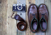 Sturdy boots, leather belt, and rangefinder camera — Stock Photo