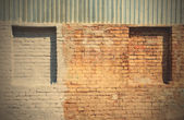 Old brick wall with blind windows — Stock Photo