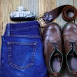 Still life with rangefinder camera, brown boots, leather belt an — Stock Photo #72858347
