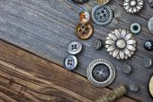 Vintage buttons on the aged wooden boards — Stock Photo