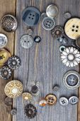 Vintage buttons on old wooden boards — Stock Photo