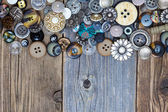 Intage buttons on aged boards surface — Stock Photo