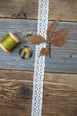 Still life with lace ribbon, vintage buttons, spools of thread a — Stock Photo