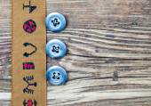 Vintage tape with embroidered ornaments and three old button — Stock Photo