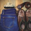 Still life with rangefinder camera, brown boots, leather belt an — Stock Photo #73397101