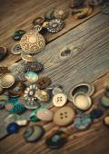 Placer of vintage buttons on aged boards — Stock Photo