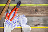 Vintage hammer, pliers, screwdriver, tape measure, gloves and sa — Stock Photo