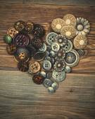 Heart from vintage classical buttons — Stock Photo