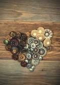 Heart from antique classical buttons — Stock Photo