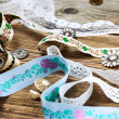 Ribbon, lace, tape with embroidery and buttons — Stock Photo #73894117