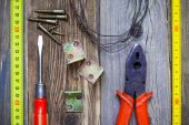 Vintage screwdriver, old pliers, screws, wire, angles — Stock Photo