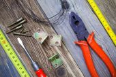 Vintage pliers, screwdriver, screws, wire, angles and roulette — Stock Photo