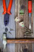 Old hammer, pliers, screwdriver old, screws and metal corners — Stock Photo