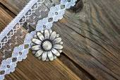 Vintage button and lace tape — Stock Photo