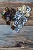 Heart from vintage colored buttons — Stock Photo