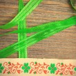 Embroidered band and green tape — Stock Photo #74764603