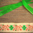 Vintage embroidered band and green tape — Stock Photo #74764665