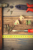 Pliers, screwdriver, screws, hammer, angles and roulette — Stock Photo