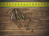 Screw and measuring tape — Foto de Stock