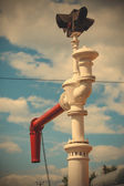 Antique water column for fueling steam locomotives — Stock Photo