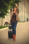 Pretty adult woman traveler with suitcase — Stock Photo