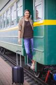 Beautiful adult woman on the steps of the passenger car — Stock Photo