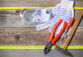 Set of the old locksmith tools, safety glasses and work gloves — Stock Photo