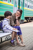 Mother and son on railroad station — Stock Photo