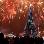 Christmas tree and fireworks — Stock Photo #57935939