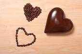 Coffee and chocolate hearts — Stock Photo