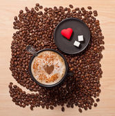 Coffee cup and heart — Stock Photo
