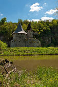Old castle near river — Stock Photo