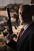 Bald hitman with the gun — Stock Photo