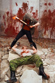 Bloody maniac with the axe is going to kill a victim — Stock Photo