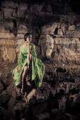 Elf woman on the rocks background. — Stock Photo