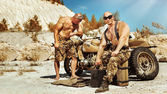 Two powerful soldiers are repairing old motorbike on the desert — Stock Photo