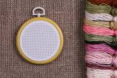 Tambour for cross stitch on sacking — Stock Photo