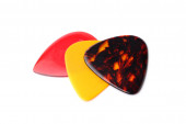 Colourful guitar plectrums — Stock Photo
