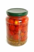 Cherry tomatoes canned in glass jar — Стоковое фото