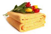 Bath towel with fresh tulips — Stock Photo