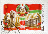 USSR - 1980: shows Red Flag, Lithuanian Arms, Flag, Red Guards Monument, devoted Lithuanian SSR, 40th anniversary — Stock Photo