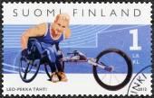 Finsko - 2012: ukazuje finské mistrů v zakázané sportu, invalidní vozík závodník Leo-Pekka Tahti, série letních paralympijských hrách — Stock fotografie