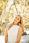 Autumn outdoor portrait of blond woman — Stock Photo