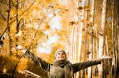 Man  throwing up piles of autumn leaves . — Stock Photo